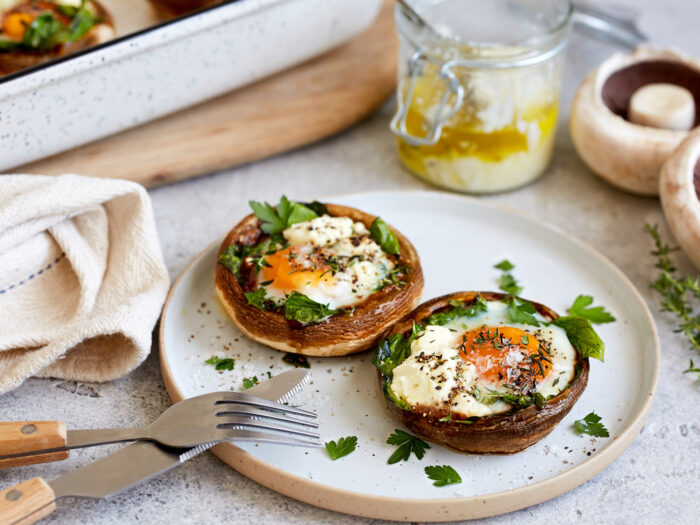 Baked breakfast mushrooms stuffed with spinach, feta and egg